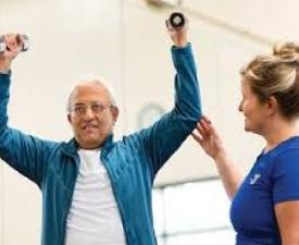 YMCA staff working out with active older adult
