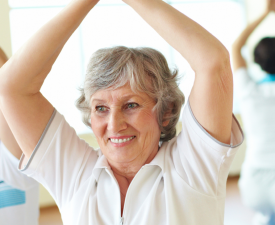 Woman stretching arms above head