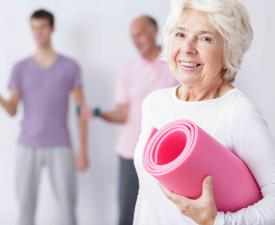 Older woman holding Yoga mat